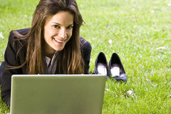 Businesswoman on the grass Royalty Free Stock Photos