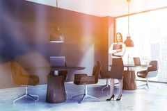 Businesswoman in gray coworking office royalty free stock images