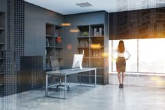 Businesswoman in gray manger office royalty free stock photography
