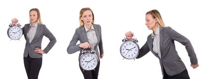 The businesswoman in gray suit holding alarm clock isolated on white Stock Photo
