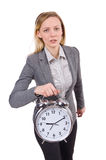 Businesswoman in gray suit holding alarm clock Royalty Free Stock Image