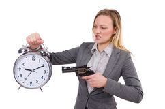 Businesswoman in gray suit holding alarm clock Stock Photography