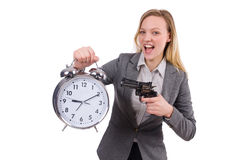Businesswoman in gray suit holding alarm clock Stock Images