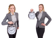 The businesswoman in gray suit holding alarm clock isolated on white Stock Images