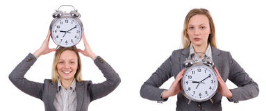 The businesswoman in gray suit holding alarm clock isolated on white Royalty Free Stock Photo