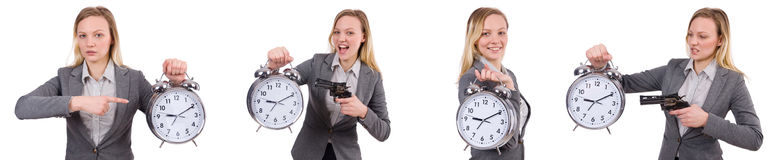 The businesswoman in gray suit holding alarm clock isolated on white Stock Photography