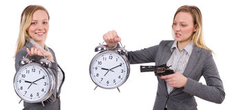 The businesswoman in gray suit holding alarm clock isolated on white Royalty Free Stock Image