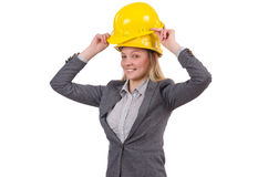 Businesswoman in gray suit and safety helmet Royalty Free Stock Photos