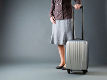 Businesswoman with a Gray Suitcase Stock Photos