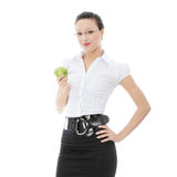 Businesswoman with green apple Stock Photos