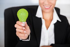 Businesswoman With Green Bulb Stock Photos