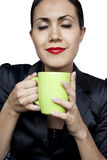 Businesswoman with a green cup Stock Images