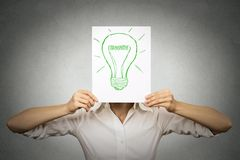 Businesswoman with green light bulb instead of head. Businesswoman with green light bulb instead of her head isolated grey wall background. Eco friendly energy royalty free illustration