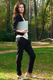 Businesswoman on a green meadow with a laptop Royalty Free Stock Photos