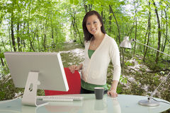 Businesswoman in Green Office stock images