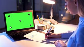 Businesswoman with green screen on computer stock footage