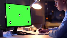Businesswoman with green screen on computer stock video