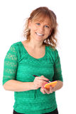 Businesswoman in green shirt holding a note and pen Royalty Free Stock Photography