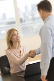 Businesswoman Greeting Candidate During Interview Royalty Free Stock Image