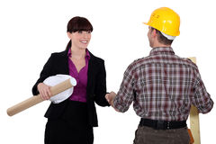 Businesswoman greeting a colleague Royalty Free Stock Image