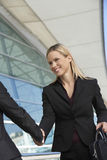 Businesswoman Greeting Female Colleague Stock Photos