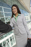 Businesswoman Greeting Male Colleague Royalty Free Stock Photography