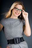 Businesswoman in grey dress Royalty Free Stock Photography