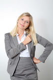 Businesswoman in grey suit Stock Photography