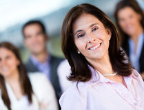 Businesswoman with a group Stock Image