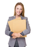 Businesswoman with group of files Royalty Free Stock Image