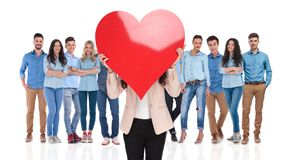 Businesswoman group leader holds valentine`s day heart in front stock image