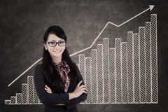 Businesswoman and growing bar chart Stock Photos
