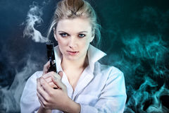 Businesswoman with gun stock photos