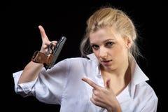 Businesswoman with gun Stock Photo