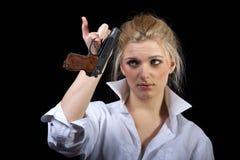 Businesswoman with gun Stock Image