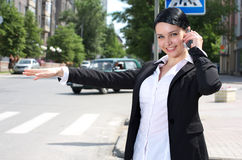 Businesswoman hailing a cab Royalty Free Stock Image