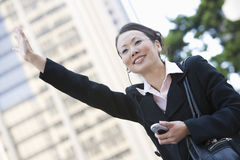 Businesswoman Hailing A Cab Stock Photography