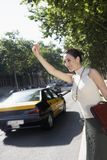 Businesswoman Hailing A Cab Stock Image