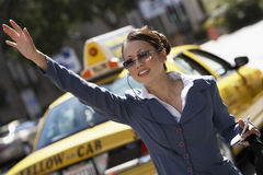 Businesswoman Hailing Cab Stock Image