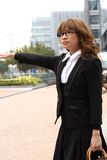 Businesswoman hailing taxi Royalty Free Stock Image