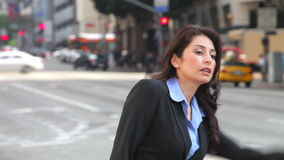 Businesswoman Hailing Taxi In Busy Street stock footage
