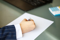 Businesswoman hand in formal wear write on paper Stock Photo