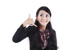 Businesswoman with hand gesture to call her Stock Photo
