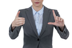 Businesswoman hand gesturing against white background. Sophisticated businesswoman gesturing against white background stock images