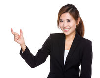 Businesswoman with hand hold small thing Royalty Free Stock Photography