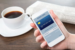 Businesswoman hand holding a phone with mobile wallet onlain sho Royalty Free Stock Photography