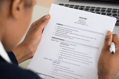 Businesswoman Hand Holding Resume. Close-up Photo Of A Businesswoman Holding Resume royalty free stock image