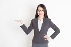 Businesswoman hand holding something Stock Photography