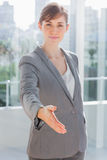 Businesswoman with hand out for handshake Stock Photo