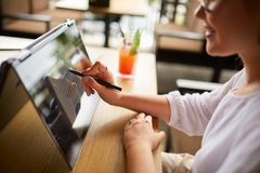 Free Businesswoman Hand Pointing With Stylus On The Chart Over Convertible Laptop Screen In Tent Mode. Woman Using 2 In 1 Royalty Free Stock Images - 126613279